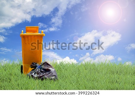 recycle bins and bag garbage on green grass and sky background ,ecology concept - stock photo