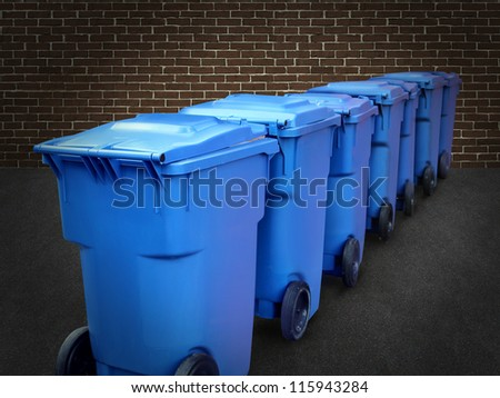 Recycle bins in a group made of commercial size blue plastic containers in a city street back alley with a brick wall as a conservation and recycling symbol of business environmental responsibility. - stock photo