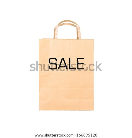 Recycle brown paper bag with sign SALE, closeup on white  - stock photo
