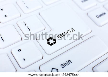 Recycle concept, close up of keyboard, recycle button - stock photo