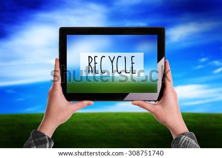 Recycle Concept, Woman with Digital Tablet Computer Taking Picture of Natural Grassland Landscape - stock photo
