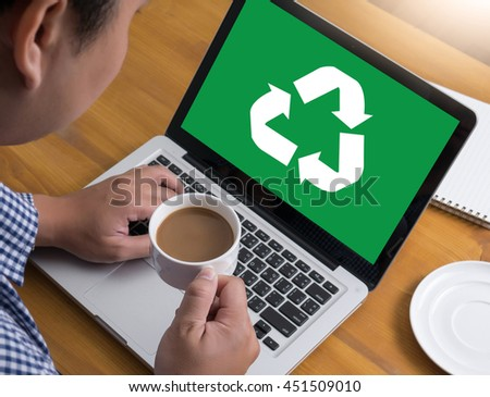 Recycle Green bio eco forest saving environment harmony ecosystem conservation csr esg campaign Businessman at work. Close-up top view of man working on laptop while sitting at the wooden desk  - stock photo