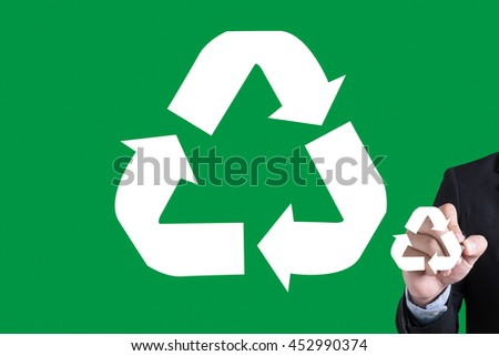 Recycle Green bio eco forest saving environment harmony ecosystem conservation csr esg campaign Businessman hand writing with black marker on white background - stock photo