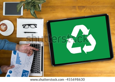 Recycle Green bio eco forest saving environment harmony ecosystem conservation csr esg campaign Businessman working at office desk and using computer and objects, coffee, top view, - stock photo