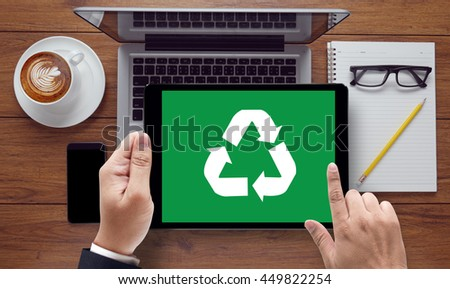 Recycle Green bio eco forest saving environment harmony ecosystem conservation csr esg campaign, on the tablet pc screen held by businessman hands - online, top view - stock photo