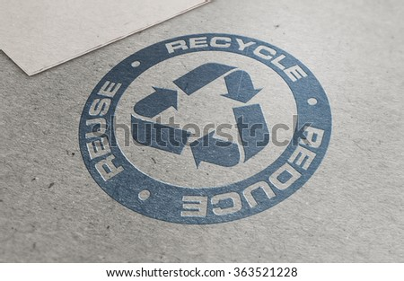 Recycle logo embossed on recycled paper background.