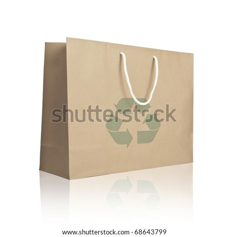 Recycle paper shopping bag on reflect white floor - stock photo
