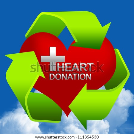 Recycle Sign Around The Red Heart With Silver Cross and Heart Donation Text Inside  in Blue Sky Background For Heart Donation Center Concept - stock photo