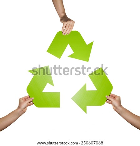 Recycle sign studio shot isolated on white background. Three hands holding three green arrows representing recycle sign - stock photo