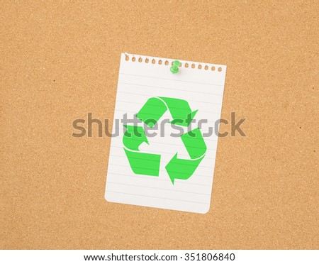 Recycle symbol on paper pinned to message board. Reminder of recycling and green lifestyle. - stock photo