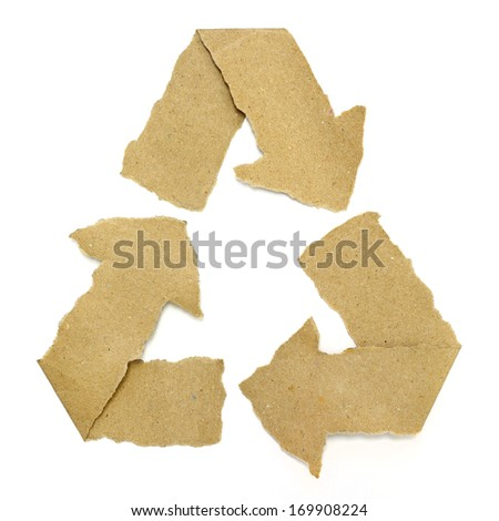 Recycle symbol torn from Recycle Paper - stock photo