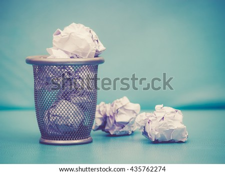 Recycle,trash bin and crumpled paper balls; vintage tone style - stock photo