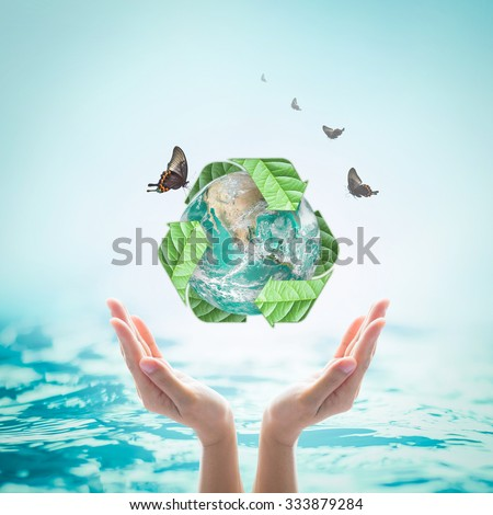 Recycled arrow sign leaf around green globe with butterflies over beautiful woman human hands on blurred abstract natural water background: Recycle concept: Elements of this image furnished by NASA    - stock photo