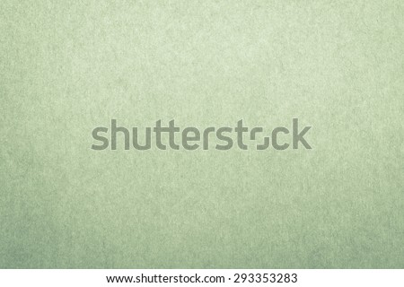 Recycled craft paper textured background in light green leaf color tone: Detailed texture of recycled paper fiber