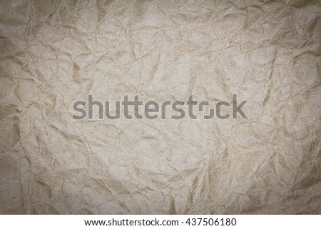 Recycled crumpled brown paper texture background for design with copy space for text or image. Dark edged. - stock photo