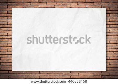 Recycled crumpled white paper on old brick wall dark edged with copy space for text or image. Blank paper texture. paper background for design. - stock photo