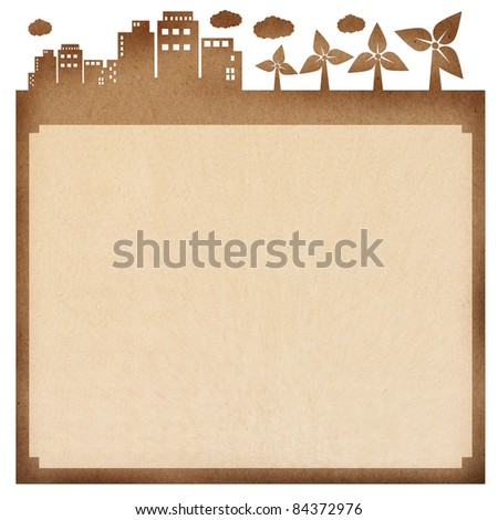 recycled paper card, cut paper with the city and wind turbine - stock photo