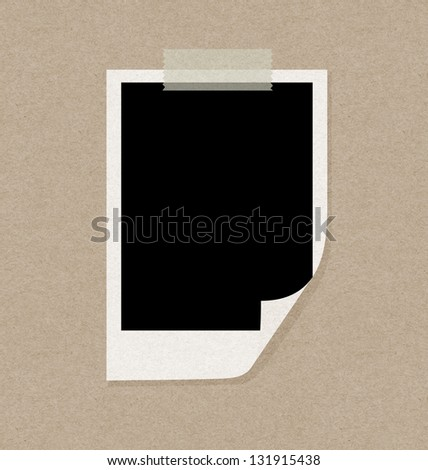 recycled papercraft polaroid on paper wall - stock photo