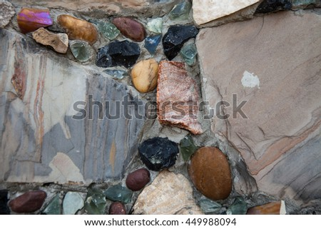 Recycled wall tiles stone, mosaic, broken glass, gravel, decoratively recycling reused.