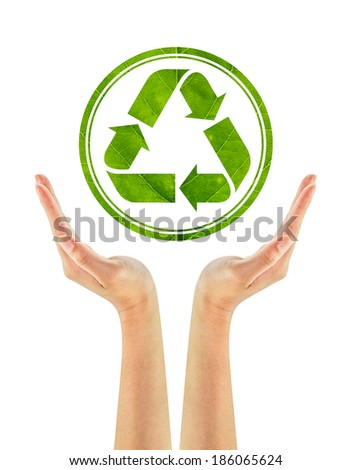 Recycling arrows made of green leaf in woman hands isolated on a white background. Ecology Concept. Environmentally friendly.
