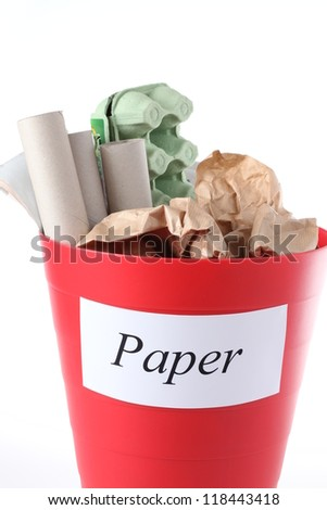 Recycling bin with paper garbage; isolated background - stock photo
