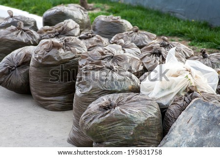 Recycling concept. Trash packs (rubbish bags) outdoors big set - stock photo