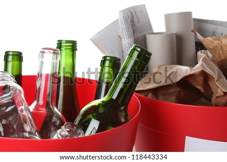 Recycling garbage: glass bottles and paper, closeup - stock photo