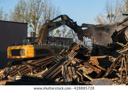 Recycling of scrap metal from demolished building - stock photo