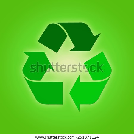 Recycling sign against green background