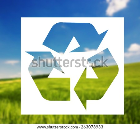 Recycling sign against landscape background
