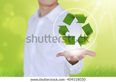 Recycling symbol on a man's hand.Caring hand hold recycle sign