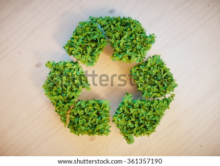 recycling symbol on wooden desk - stock photo