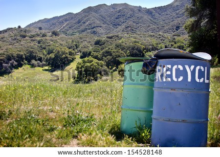 Recycling trash cans outside in a park.  - stock photo
