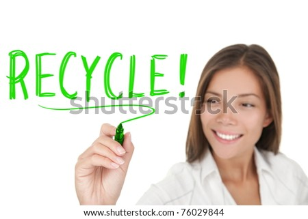 Recycling. Woman writing recycle with green marker isolated on white background. Asian Caucasian businesswoman. - stock photo