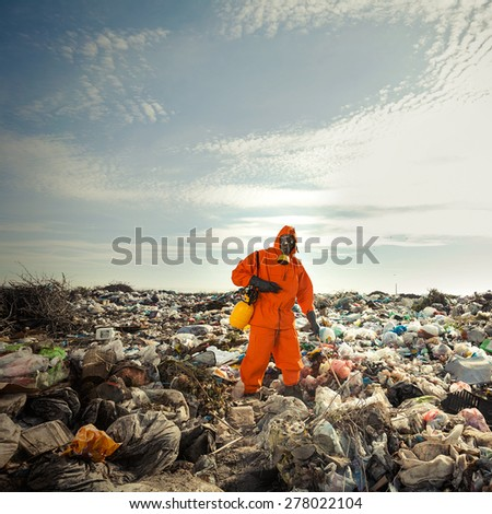 Recycling worker measuring pollution on the landfill - stock photo