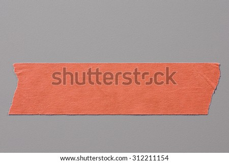 Red Adhesive Tape on Grey Background with Real Shadow. Top View of  Masking Tape, Label or Paper Tag. Sticker Close Up with Copy Space for Text or Image