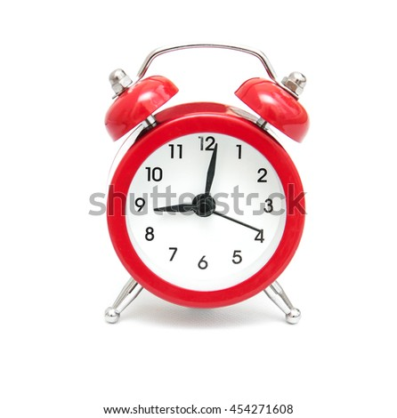 Red alarm clock isolated on a white background