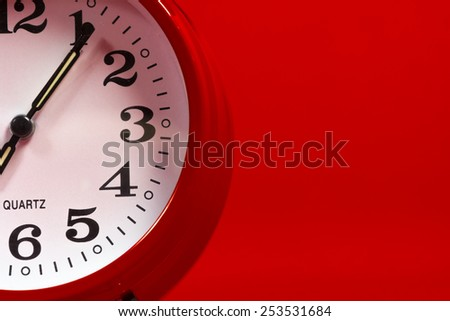 Red alarm clock on a red background with copy space - stock photo