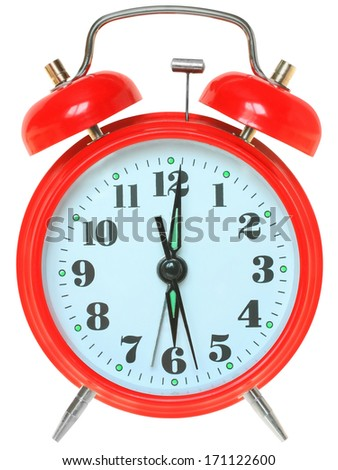 Red alarm clock on a white background. - stock photo