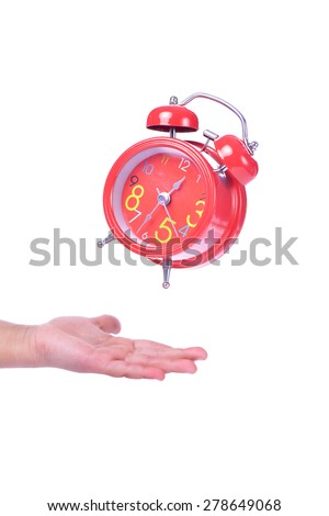 Red Alarm clock on child hand - stock photo