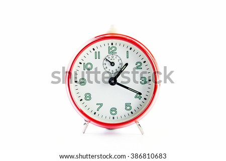 Red alarm clock on the white background