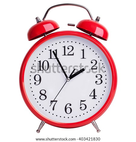 Red alarm clock shows five minutes to two - stock photo