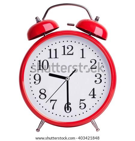 Red alarm clock shows half past nine - stock photo