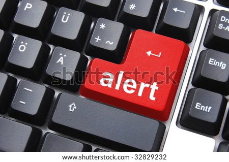 red alert button on a black computer keyboard