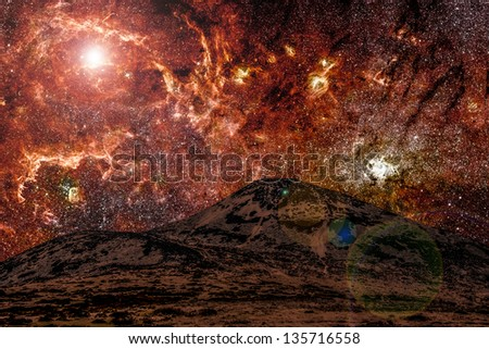 Red alien landscape with mountain in a far away galaxy - elements of this image are furnished by NASA - stock photo