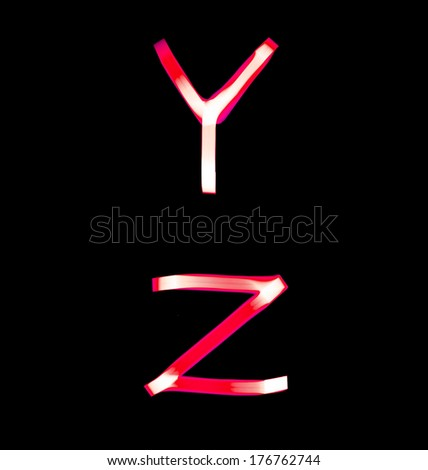 red alphabet created with light (Y, Z) - stock photo