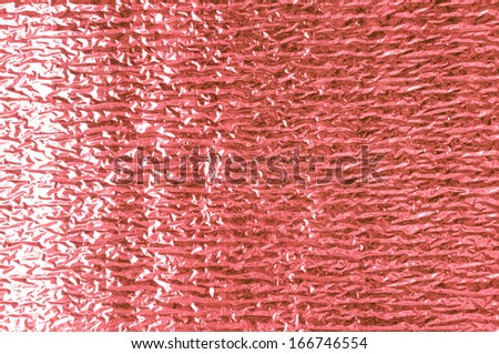 Red aluminum foil texture closeup , can be used for background - stock photo