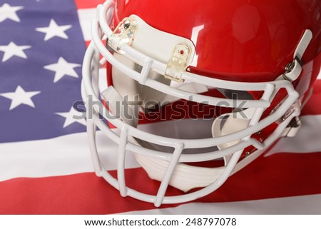 Red American Football Helmet On American Flag - stock photo