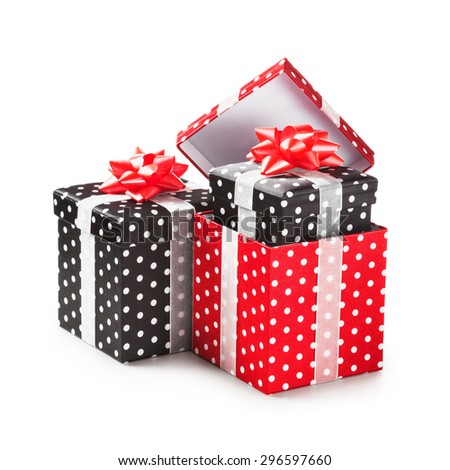 Red and black gift boxes with white dots and ribbon bow. Holiday present. Object group isolated on white background. Clipping path