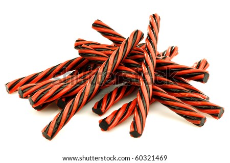 red and black licorice candy on a white background